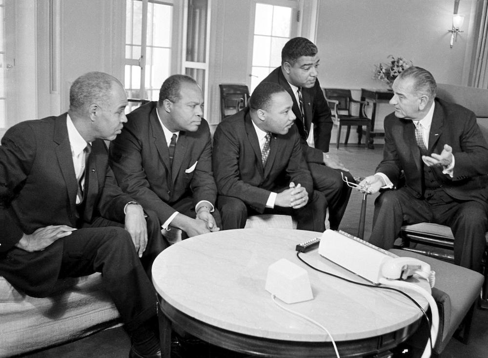 Lyndon Johnson discussing civil rights in 1964 with Roy Wilkins, James Farmer, Martin Luther King Jr. and Whitney Young. (AP)