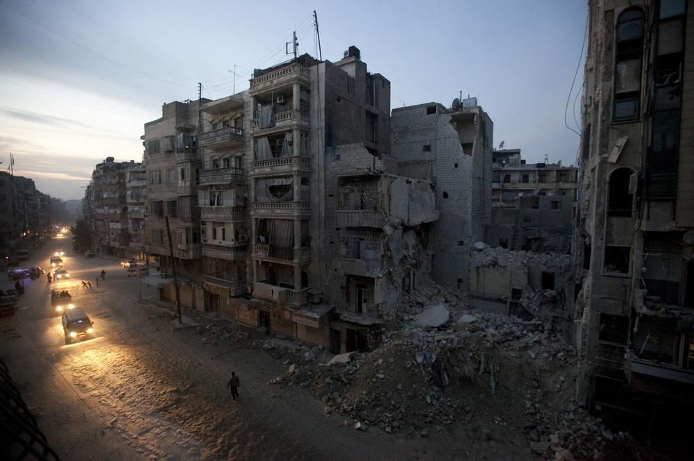 Syrian rebel-controlled area of Aleppo, as destroyed buildings, including Dar Al-Shifa hospital, are seen on Sa'ar street after airstrikes targeted the area a week before. More than 100,000 people have been killed since the start of Syria's conflict over two years ago, an activist group said Wednesday. (AP)