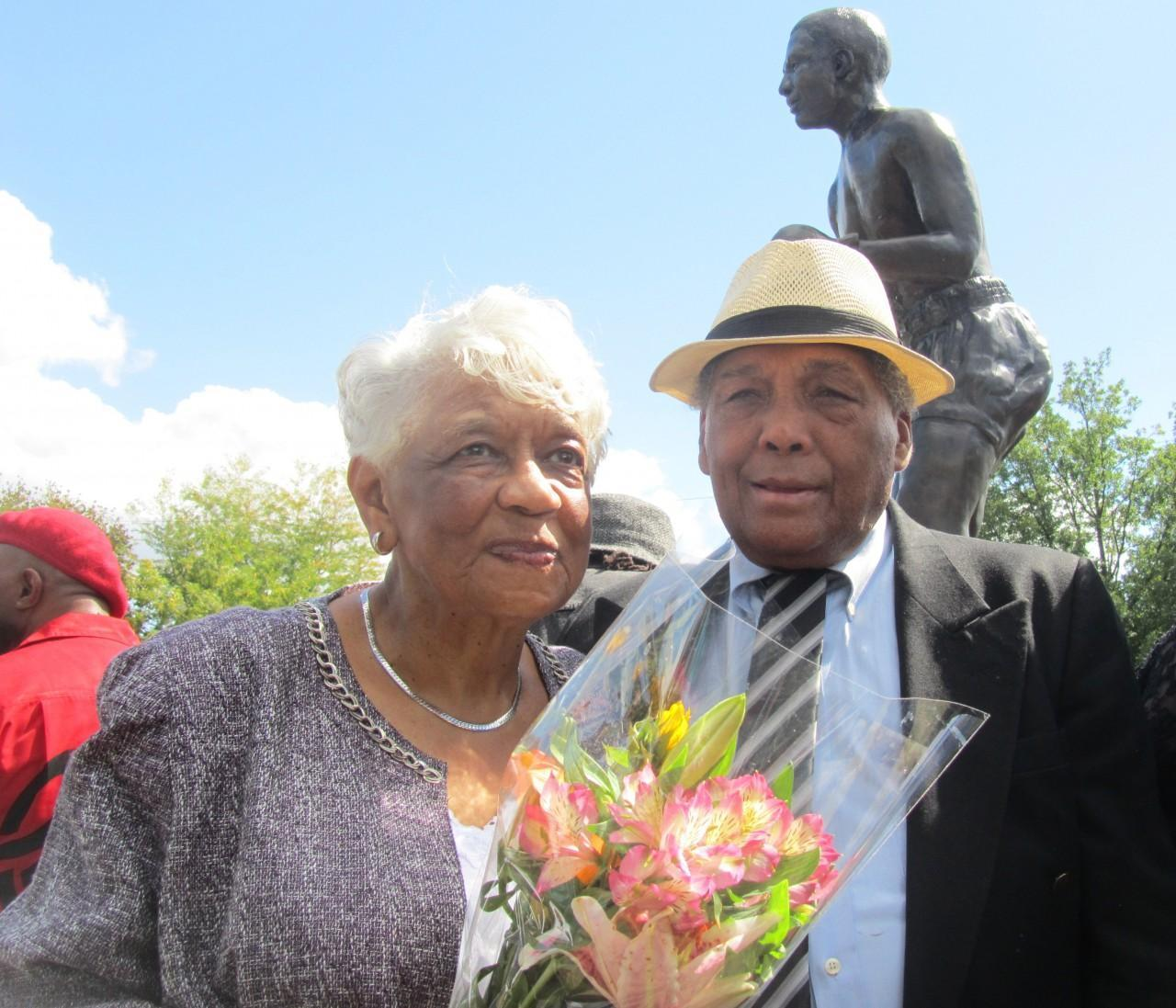 Geraldine Moore and Sugar Ramos share a moment at the unveiling of the Davey Moore statue. Moore died after a championship boxing match with Ramos in 1963. (Mike Foley/Only A Game)