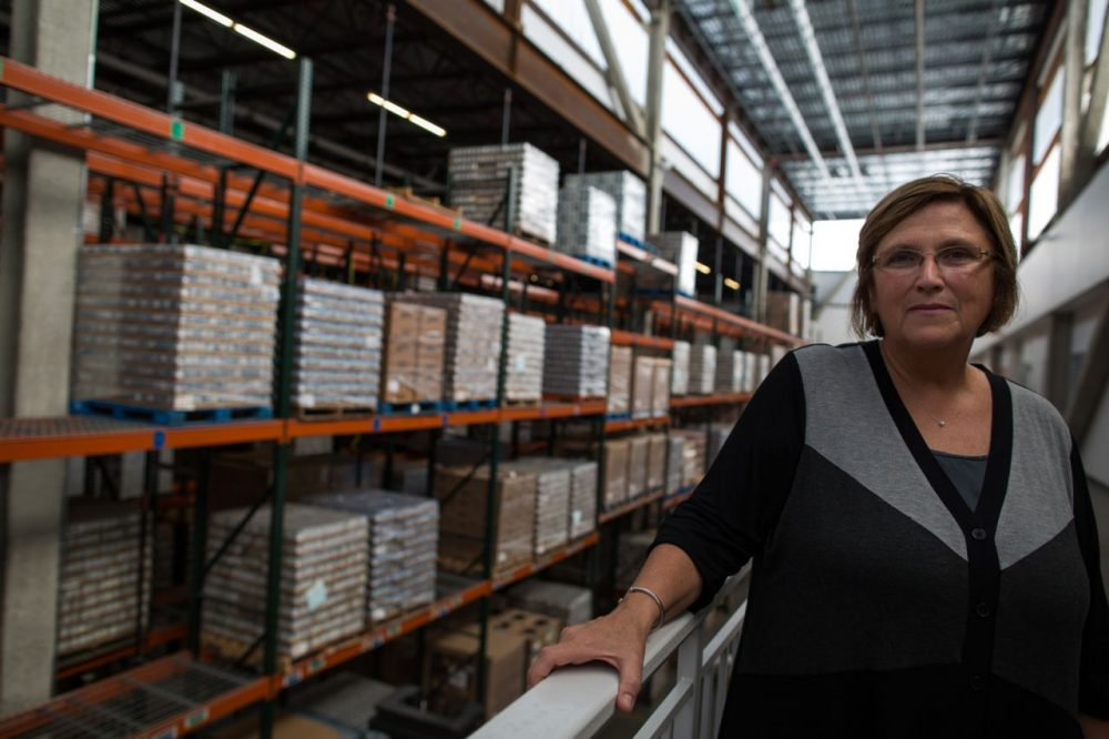 Greater Boston Food Bank President Catherine D'Amato in the warehouse in a 2013 file photo (Joe Spurr/WBUR)