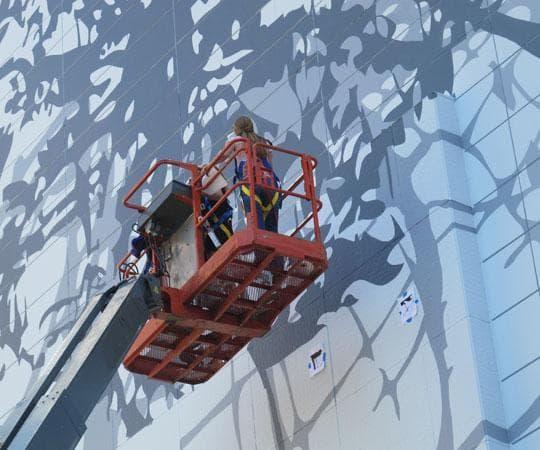 A crew paints Matthew Ritchie's vision. (Andrea Shea/WBUR)