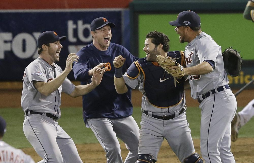 Members of the Detroit Tigers celebrate after winning against the Oakland A's on Thursday, Oct. 10, 2013. The win means the Tigers will proceed to the American League Championship Series against the Boston Red Sox. (Jeff Chiu/AP)