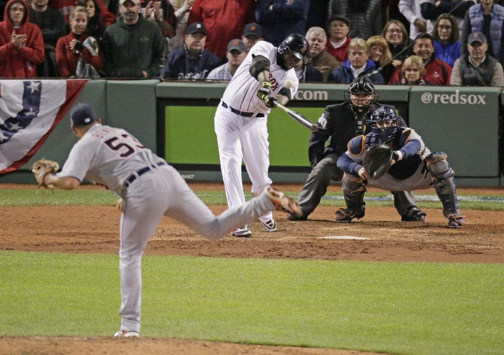 Red Sox David Ortiz hits a game-tying grand slam in the eighth inning of Game 2 of the ALCS against the Tigers Sunday night in Boston. (Charlie Riedel/AP)