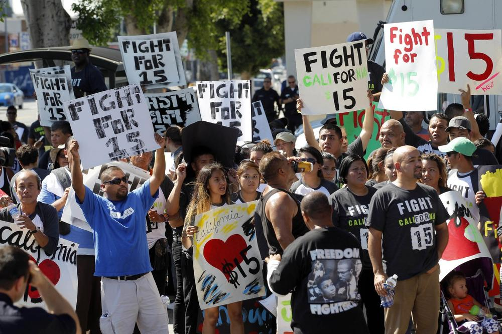 Protesters demonstrate outside a fast food restaurant on Thursday, Aug. 29, 2013, in Los Angeles. (Nick Ut/AP)