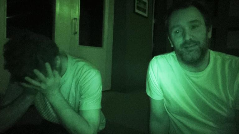 "This Tuesday, Oct. 15, 2013 photo released by Comedy Central shows co-creators Matt Stone and Trey Parker of ""South Park"" during the power outage at South Park Studios. (Comedy Central)"