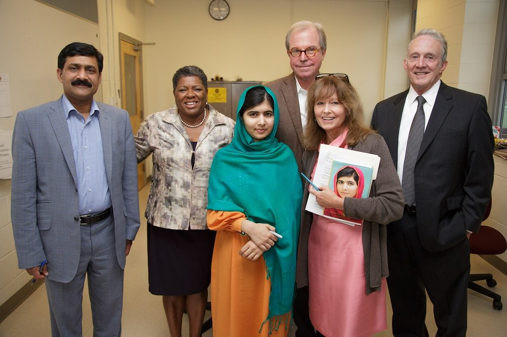 "From left: Ziauddin Yousafzai, Jackie Jenkins- Scott, President of Wheelock College, Malala Yousafzai, Nicholas Negroponte, founder of ""One Laptop per Child"" Association,  Robin Young, host of Here & Now, and Tom McNaught, executive director of the John F. Kennedy Library Foundation. (Tom Fitzsimmons)"