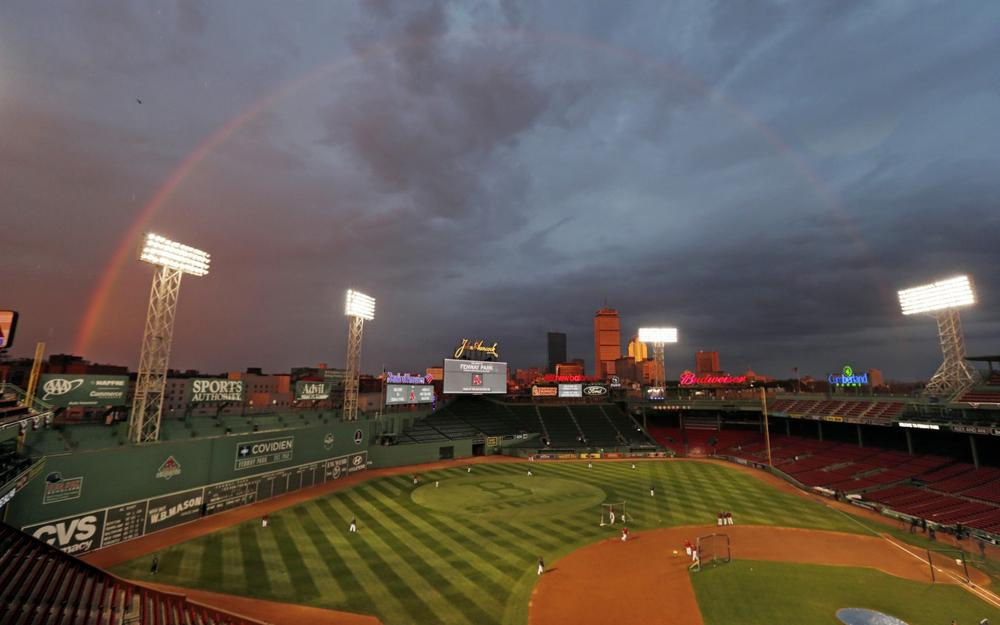 The Red Sox are scheduled to host the St. Louis Cardinals in Game 1 of baseball's World Series today. A rainbow above Fenway Park is pictured yesterday in Boston. (Charles Krupa/AP)