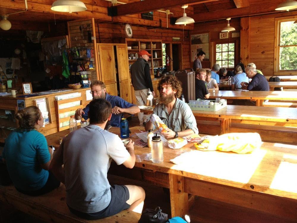 Travelers on the Appalachian Trail take a break at the Mizpah Spring Hut. (Chris Ballman/Here & Now)