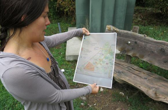 Stephanie Syson of the Central Rocky Mountain Permaculture Institute looks at plans for a proposed food forest in Basalt, Colo. (Luke Runyon/Harvest Public Media)