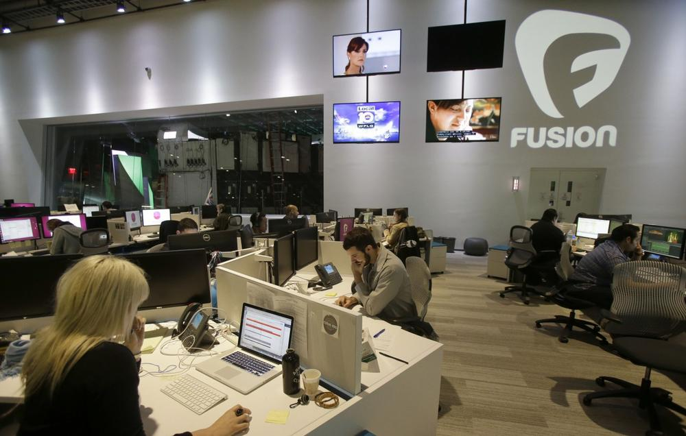 Workers are shown in the Fusion network's warehouse-turned-news hub known as Newsport, in Doral, Fla, Oct. 14, 2013. The English-language television network is targeting millennial Hispanics. (Wilfredo Lee/AP)