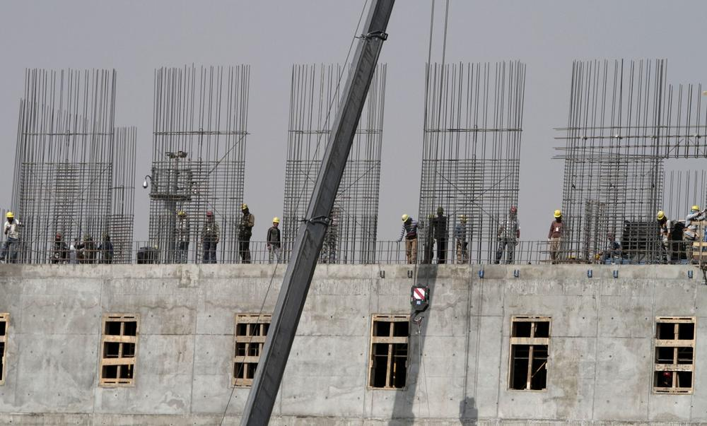 Afghan construction workers install steel reinforcement bars on a building to be used by the Afghan National Army in Kabul, Afghanistan, Tuesday, Oct. 8, 2013. (Rahmat Gul/AP)