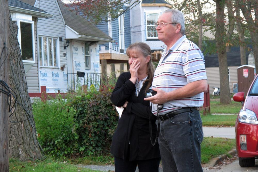 Sue Sutton, left, fights back tears as she watches her home being demolished, with her husband, Bart, in Union Beach, N.J., Oct. 2, 2013. Their home was one of thousands at the Jersey shore that had to be demolished after being damaged by Superstorm Sandy. (Wayne Parry/AP)