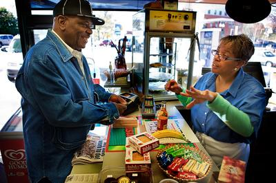 Stacey Thomas, right, works seven days a week at the family's Mobil Station on Blue Hill Avenue in Mattapan Square. (Jesse Costa/WBUR)