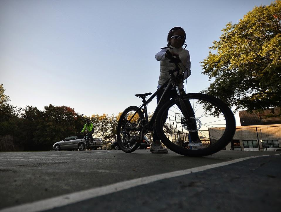 A child bikes near Dudley Square in this 2013 file photo. (Alex Kingsbury/WBUR)
