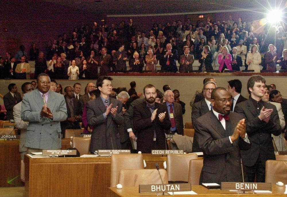 Supporters applaud as Hans Corell, the UN under secretary-general for legal affair announces the ratification of the Rome treaty, which establishes the International Criminal Court Thursday, April 11, 2002 at the United Nations headquarters in New York Thursday April 11, 2002. (Osamu Honda/AP)