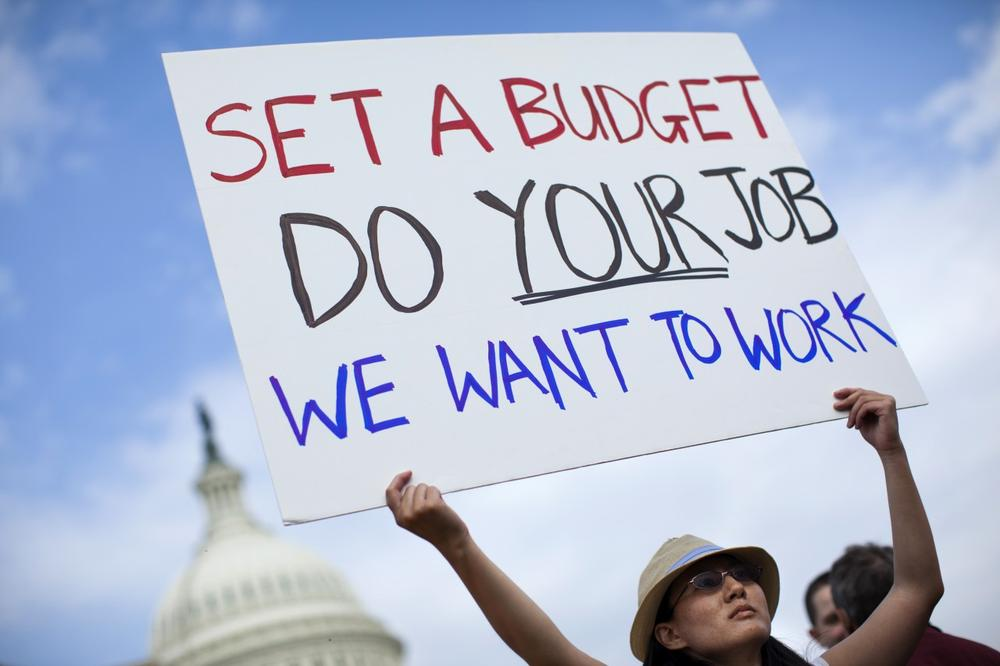 A woman who wished to be identified as Nancy, holds a sign during an event with the Democratic Progressive Caucus with furloughed federal employees blaming House Republicans on the government shutdown on Capitol Hill on Friday, Oct. 4, 2013 in Washington. (AP)