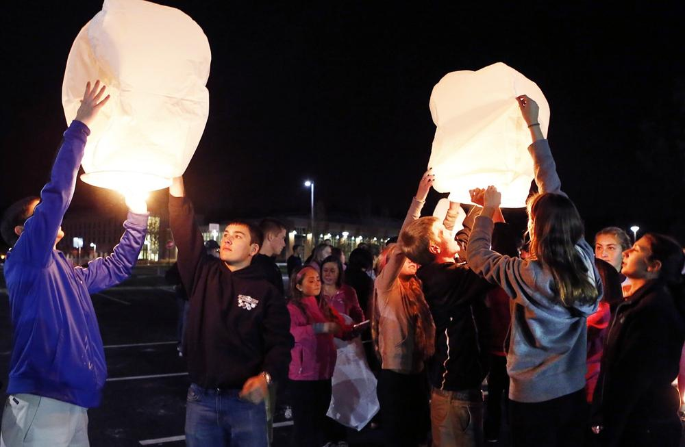 Danvers High School students prepare to launch sky lanterns during a candlelight vigil to mourn the death of Colleen Ritzer, a 24-year-old math teacher at the school, on Wednesday, Oct 23, 2013, in Danvers, Mass. (AP/Bizuayehu Tesfaye)