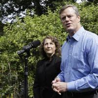 Republican gubernatorial candidate Charles Baker and his wife Lauren outside their home in Swampscott, Mass. (AP/Steven Senne)