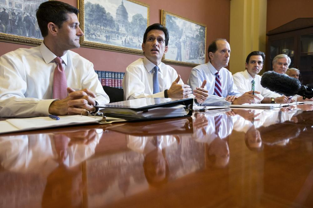 With the federal government out of money and out of time, House Majority Leader Eric Cantor, R-Va., center, meets with House GOP conferees as the Republican-controlled House and the Democrat-controlled Senate remain at an impasse, neither side backing down over Obamacare, at the Capitol in Washington, Tuesday, Oct. 1, 2013. (AP)