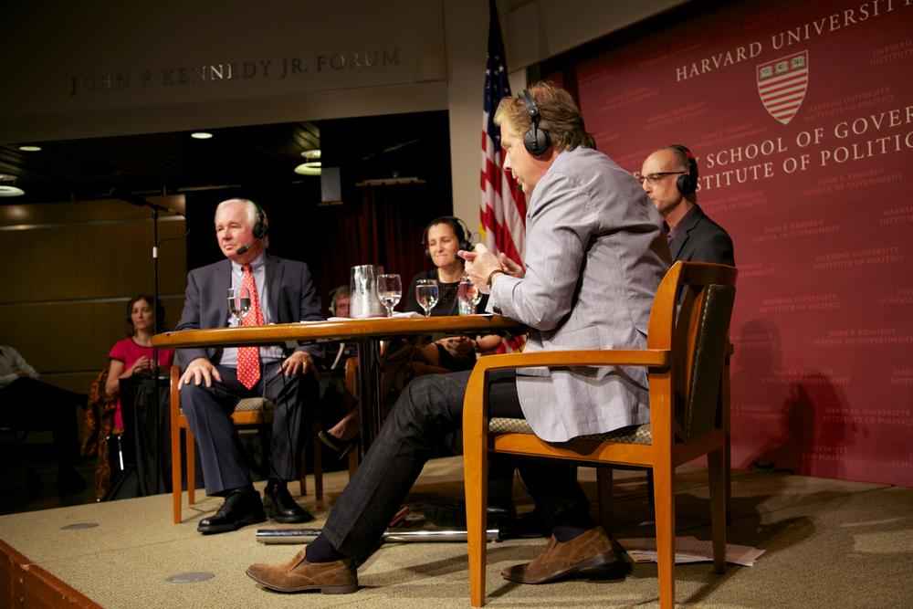 On Point host Tom Ashbrook leads the discussion at the Harvard Kennedy School's kickoff event for its Challenges to Democracy series on Thursday, October 3, 2013. Harvard's Alex Keyssar, Canadian journalist and Liberal Party candidate Chrystia Freeland and Princeton University's Martin Gilens joined Tom on stage. (WBUR)
