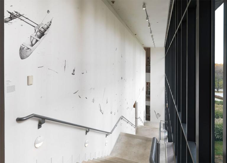 """""""Flotilla"""" is sprawled on the wall along the museum's main staircase. (Courtesy of the artist/Clements Photography and Design)"""