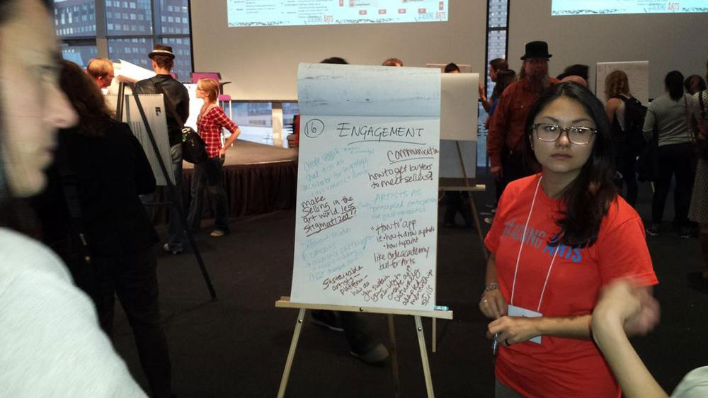 Emi Kioizumi, student at MIT Sloan School of Management, leads a discussion before the hackathon. (Franklin Einspruch)