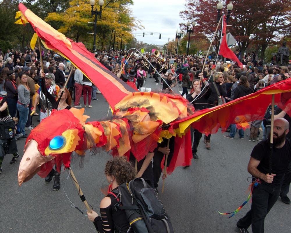 A giant firebird puppet—with smoking breath—by Artisan's Asylum of Somerville flies through Harvard Square. (Greg Cook)