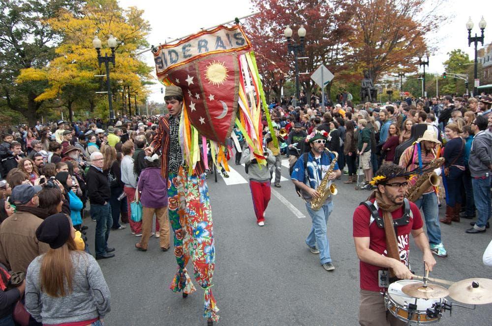 Os Siderais of Rio de Janeiro, Brazil, parades through the throng at Harvard Square. (Greg Cook)