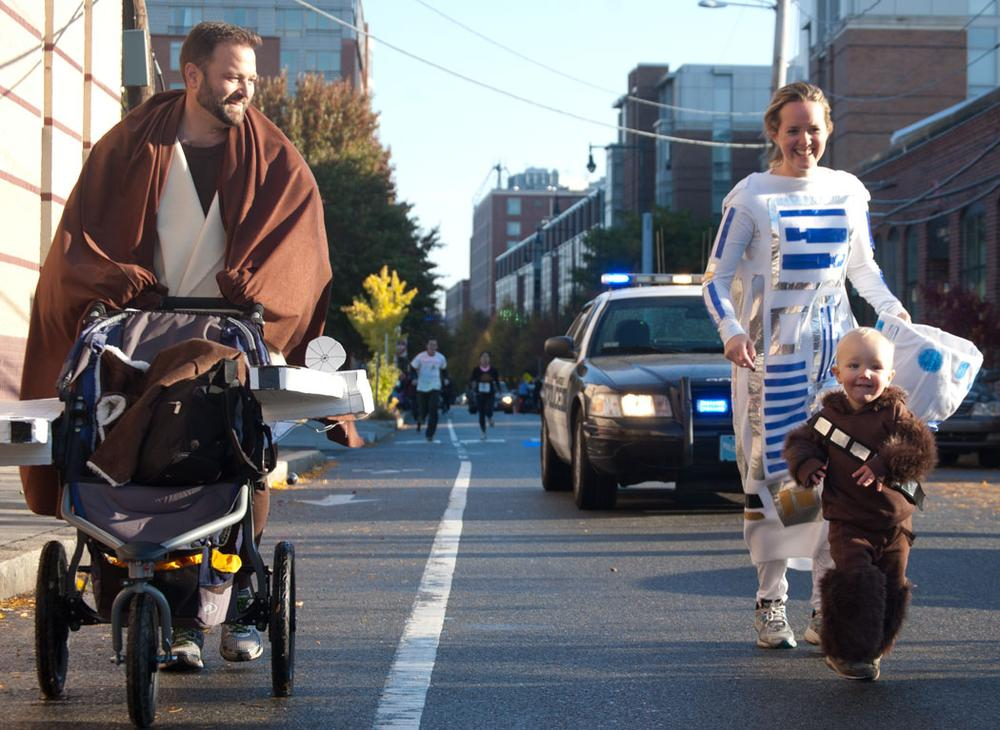 Obi-Wan (?), R2-D2 and Chewbacca with a stroller Millennium Falcon on Sidney Street. (Greg Cook)