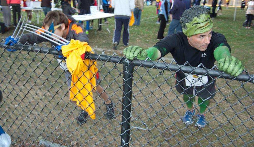Hulk must stretch. Wolverine also gets the kinks out at Pacific Street Park before the race. (Greg Cook)