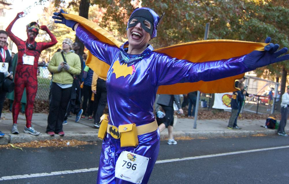 A 1960s-television-style Batgirl approaches the finish. (Greg Cook)