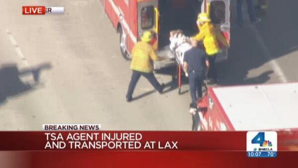 A still image from NBC LA shows a person being loaded into an ambulance at Los Angeles International Airport. (Joseph Weisenthal/Twitter)