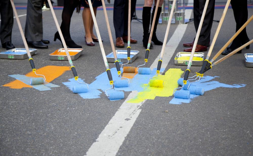 A painted yellow line will accompany the traditional blue line guiding participants in Sunday's race to the finish. (Courtesy of New York Road Runners)