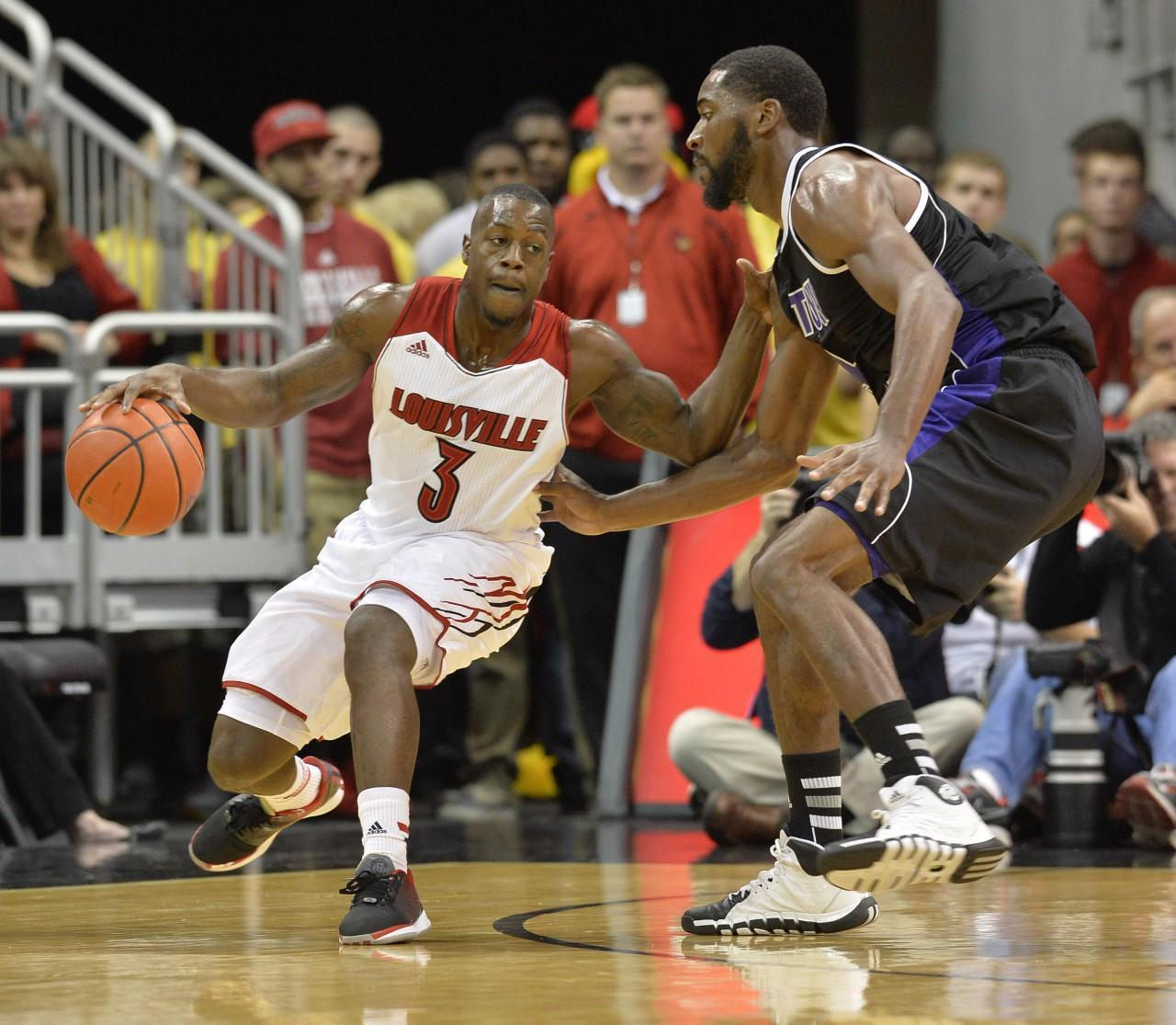 Louisville may be the defending champs, but they enter the season ranked No. 3. (Timothy D. Easley/AP)
