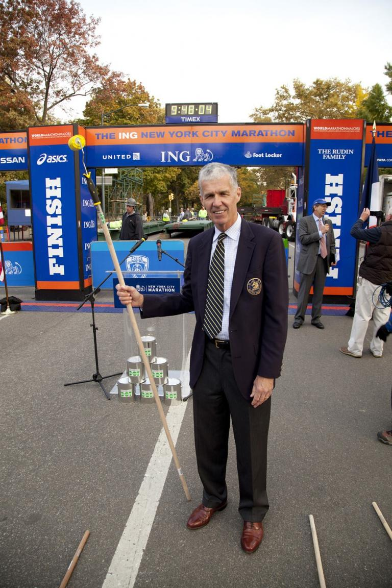 Tom Grilk, executive director of the Boston Athletic Association, was in New York on Wednesday to help paint a symbolic yellow line alongside the regular blue line that marks the New York Marathon course every year. (Courtesy of New York Road Runners)