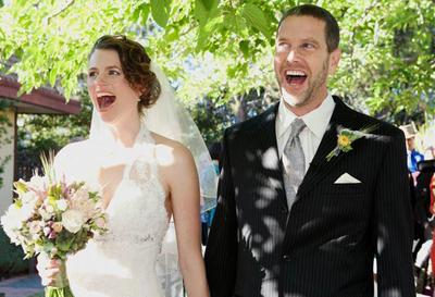 "Jessica Wolk and Jim Benson on their real wedding day, which they call their ""light wedding."" (Courtesy of the Bensons)"