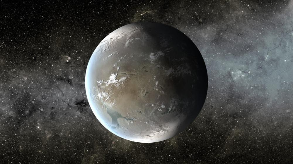 """An artist's illustration of Kepler-62f, a planet in the """"habitable zone"""" of a star that is slightly smaller and cooler than ours. (<a href=""""http://kepler.nasa.gov/multimedia/artwork/artistsconcepts/?ImageID=260"""" target=""""_blank"""">NASA/JPL-Caltech/T. Pyle</a>)"""