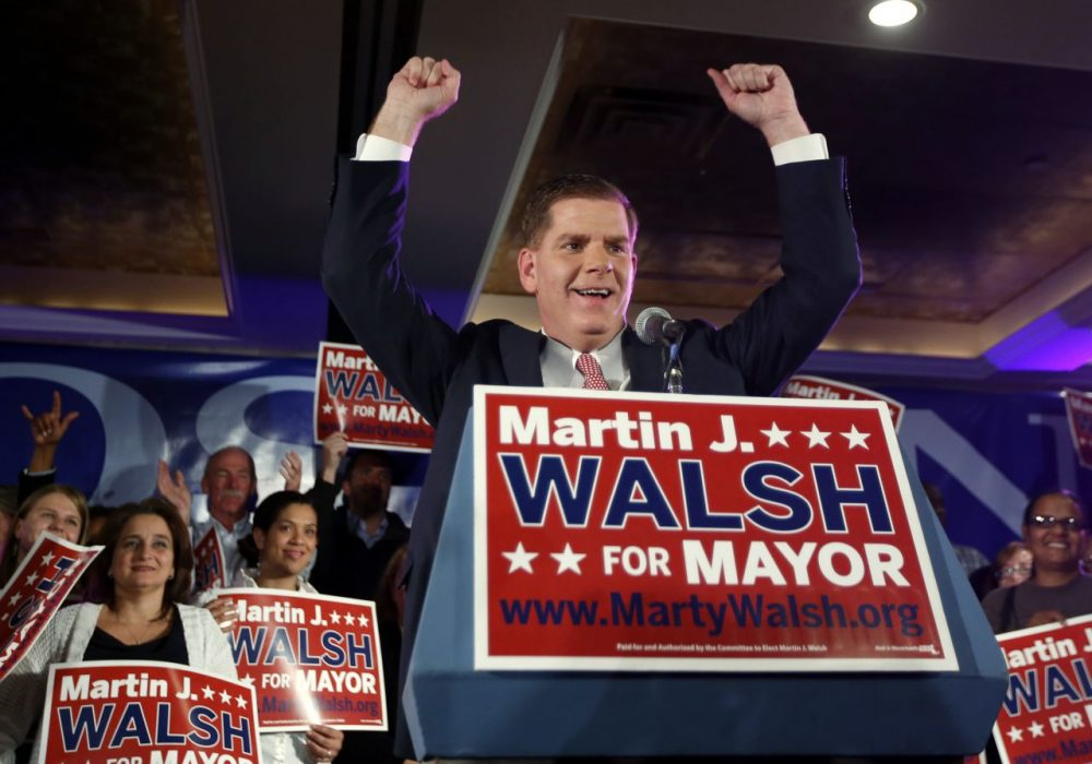 Marty Walsh gestures to supporters at his primary election night party. (Elise Amendola/AP)