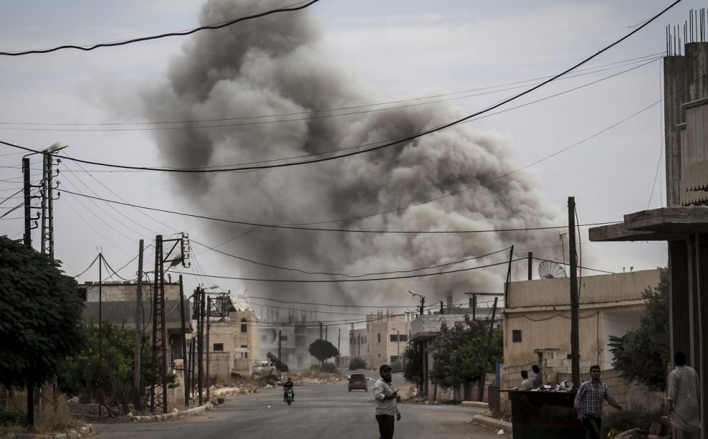 Smoke rises after an air strike, Sept. 22, 2013, in a village that has been turned into a battlefield between Free Syrian Army fighters and government forces in Idlib province, northern Syria. (Narciso Contreras/AP)