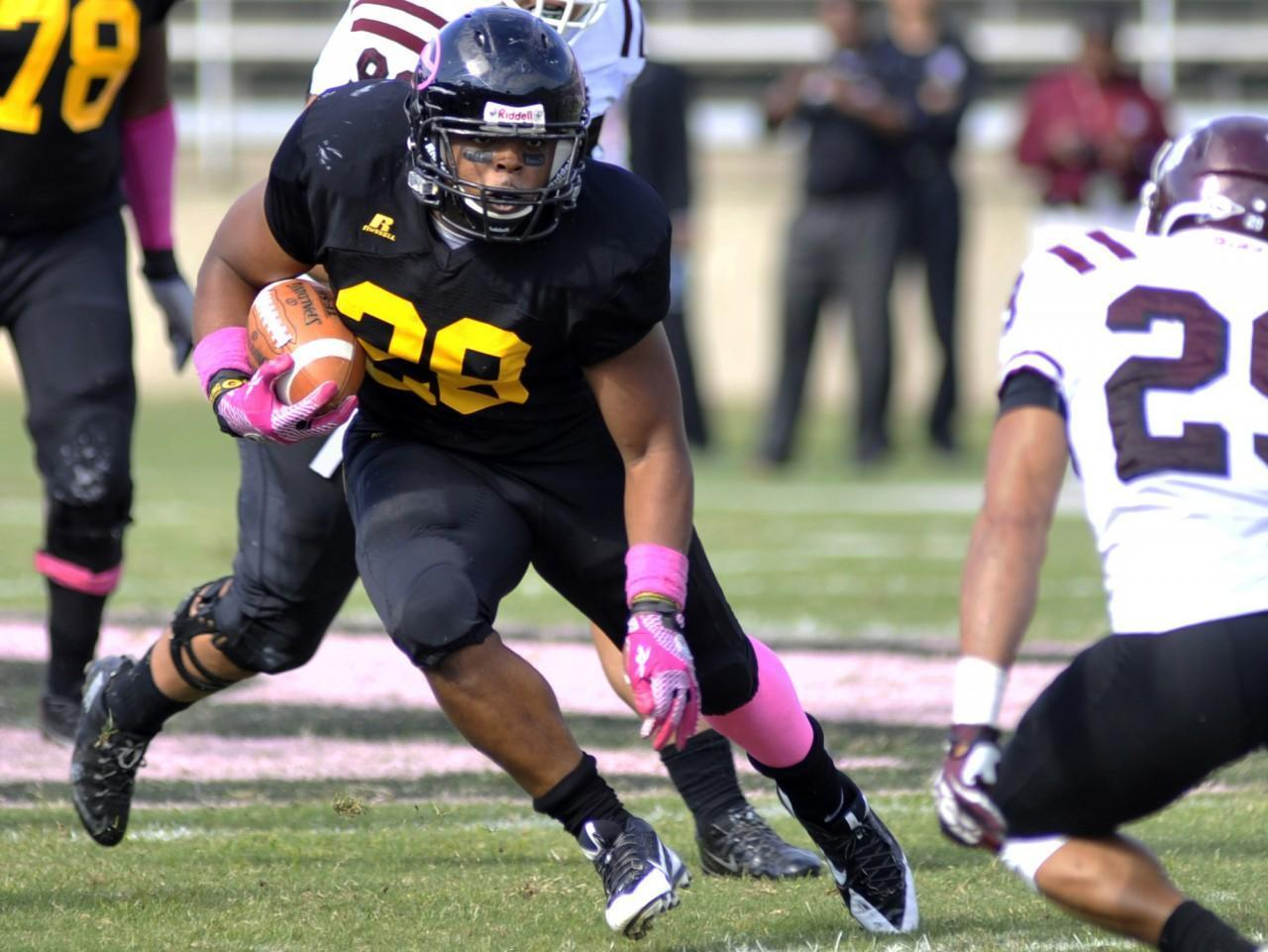 0b9e4cfc7 Grambling running back Jestin Kelly (28) searches for running room against  Texas Southern in