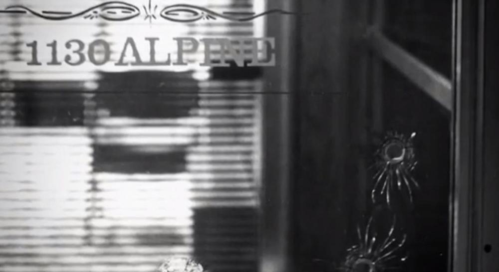 """Bullet holes in the front window of an abortion doctor's office. (Screenshot from """"After Tiller"""")"""