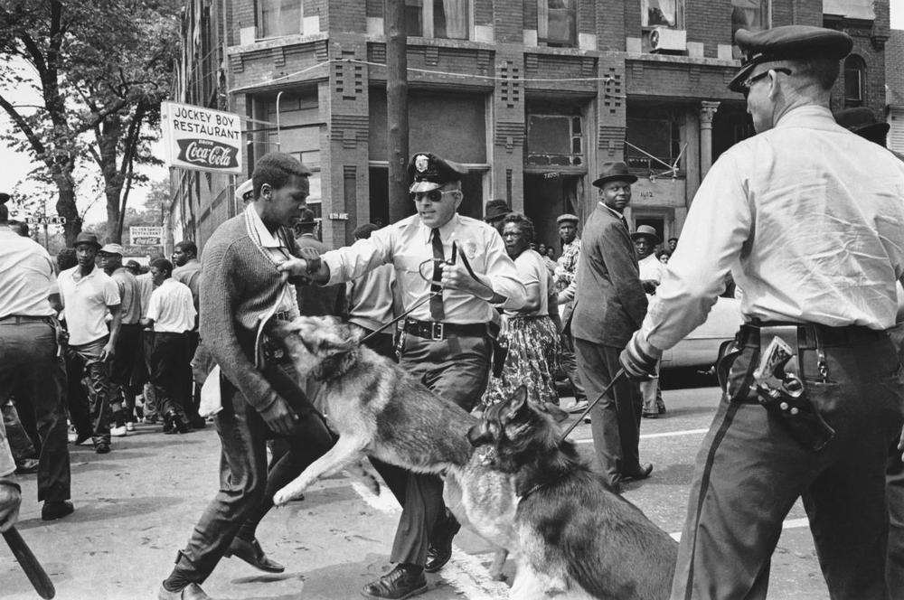 A 17-year-old civil rights demonstrator, defying an anti-parade ordinance of Birmingham, Ala., is attacked by a police dog on May 3, 1963. President Kennedy discussed this photo, which had appeared on the front page of that day's New York Times. (Bill Hudson/AP)