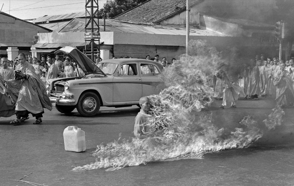In the first of a series of fiery suicides by Buddhist monks, Thich Quang Duc burns himself to death on a Saigon street to protest persecution of Buddhists by the South Vietnamese government, June 11, 1963. (Malcolm Browne/AP)