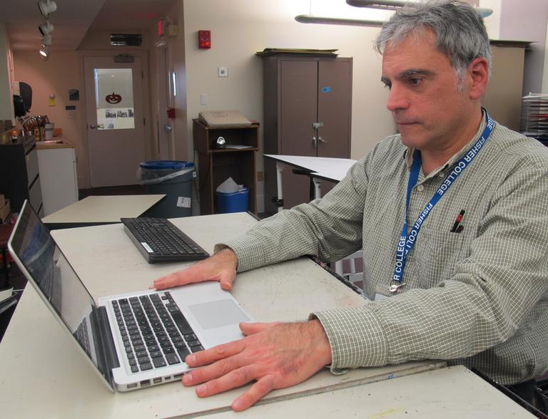 Jeff Freedner, 57, has had issues re-enrolling in coverage via the new Health Connector website. (Martha Bebinger/WBUR)