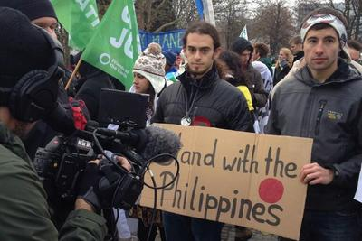 "Adam Greenberg, a delegate with SustainUS at the U.N. Climate Change Conference in Warsaw, Poland, is interviewed along with other fasters. (<a href=""https://twitter.com/Agent350/status/401703589611323392"" target=""_blank"">Jamie Henn/Twitter</a>)"