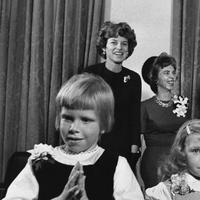 Sheila McGrath, 7, left, and her sister, Kammy, 5, poster children for the drive for funds for retarded children, are White House visitors.    Adults, from left, are Mrs. Eunice Shriver, the President's sister; Mrs. Richard McGrath of Arvada, Colo., the girls' mother; Dr. Leonard Mayo of New York, chairman of the President's Panel on Mental Retardation, and President John Kennedy shown Nov. 14, 1961 in Washington. (AP Photo)