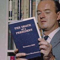 "Author William Manchester poses in New York with his book, ""The Death of a President,"" on March 17, 1967. (AP)"