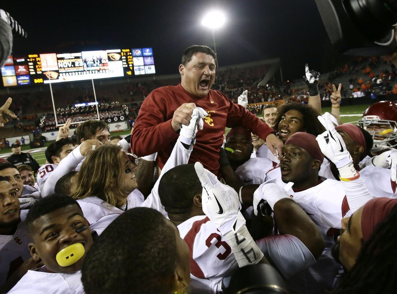 Ed Orgeron celebrates USC's first win at Oregon State since 2004. (Don Ryan/AP)