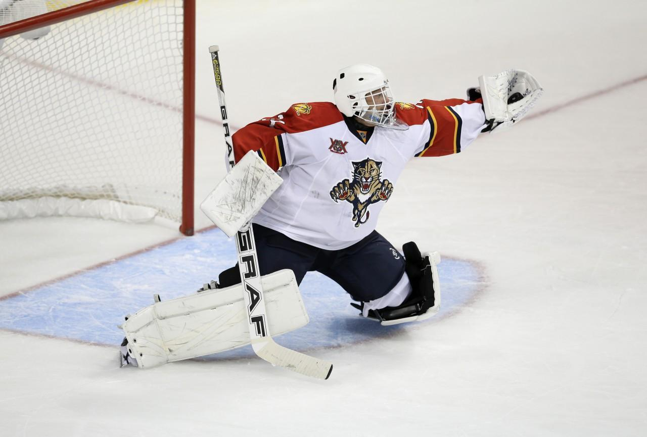 After taking a year off, Tim Thomas is in goal for the Florida Panthers. (Tony Gutierrez/AP)