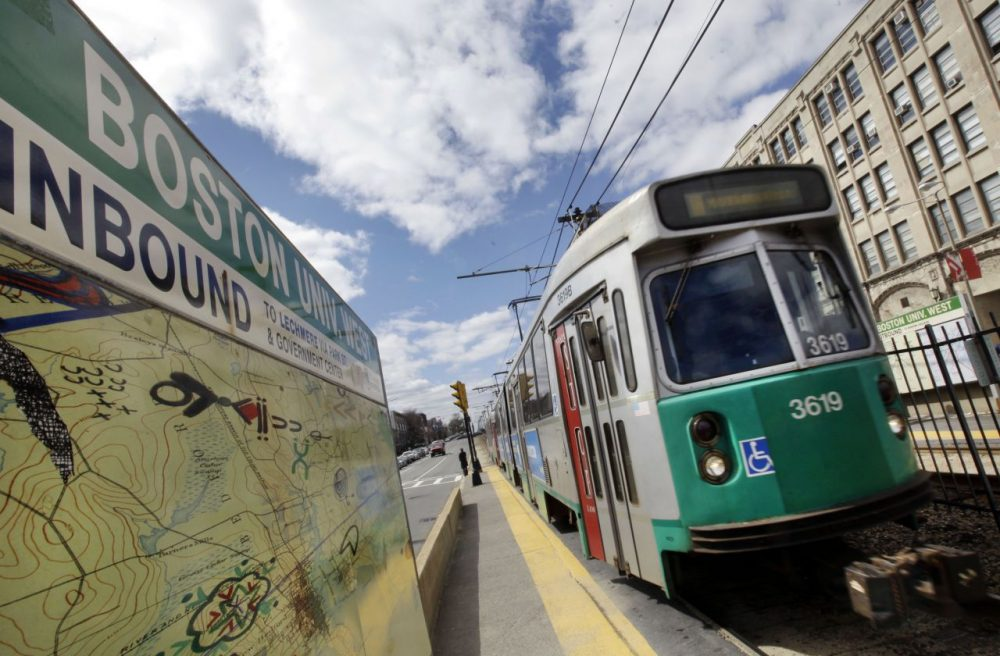 An MBTA train pulls into a stop on Commonweath Avenue near Boston University. (Elise Amendola/AP)
